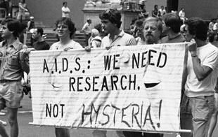 A group advocating AIDS research marches down Fifth Avenue during the 14th annual Lesbian and Gay Pride parade in New York, June 27, 1983. Mario Suriani/Associated Press